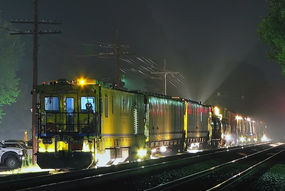 Image result for photo of rail grinders working at night with sparks flying